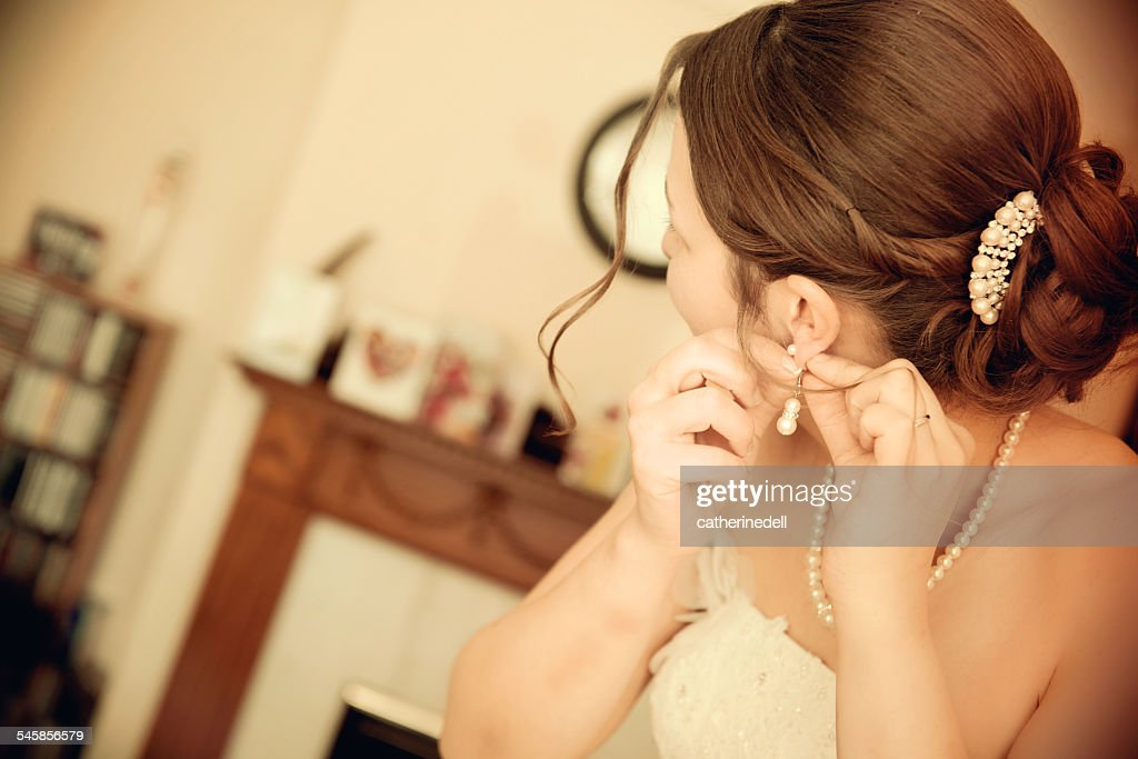 Bride preparing for wedding : Stock Photo