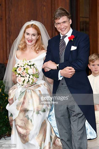 Bride Princess Maria Theresia von Thurn und Taxis and groom Hugo Wilson leave the St Joseph church after the wedding ceremony on September 13 2014 in...