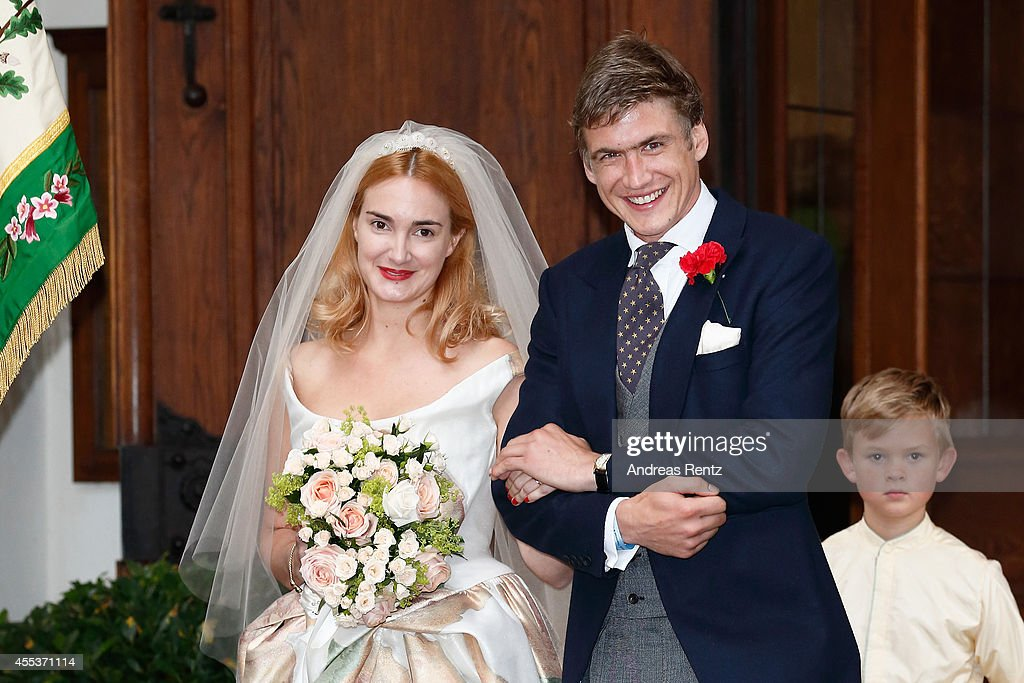 Bride Princess Maria Theresia von Thurn und Taxis and groom Hugo Wilson leave the church after the wedding ceremony on September 13, 2014 in Tutzing, Germany.