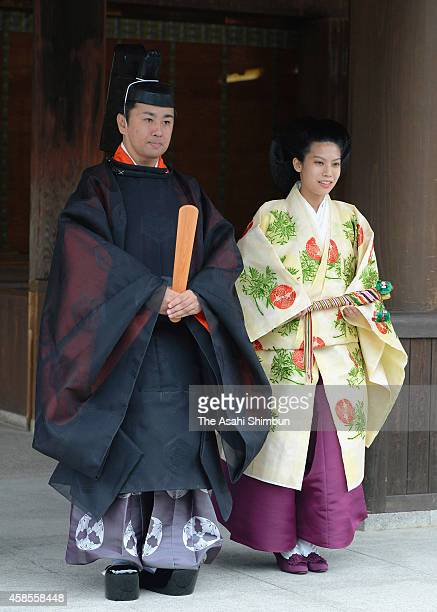 Bride Princess Noriko of Takamado and groom Kunimaro Senge speak to media after their wedding ceremony at the Izumo Taisha grand shrine on October 5...