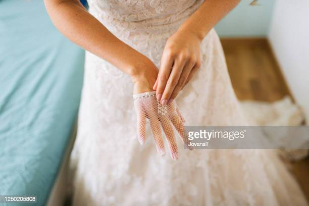 bride putting her white lace gloves - lace glove stock pictures, royalty-free photos & images