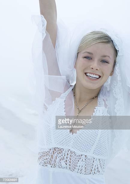 Bride reaching into air