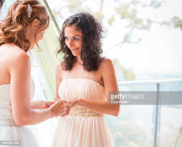 A bride receives her wedding ring from her bride during a same-sex wedding in Australia.