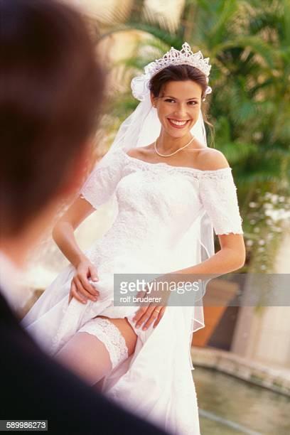 Bride Revealing Garter Belt for Bridegroom