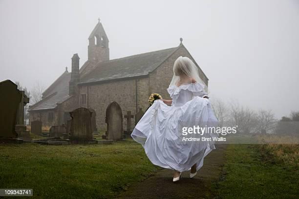 bride running away from a church