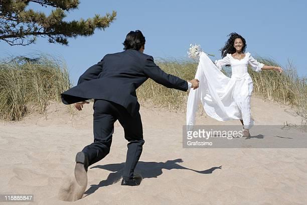 Bride running towards groom