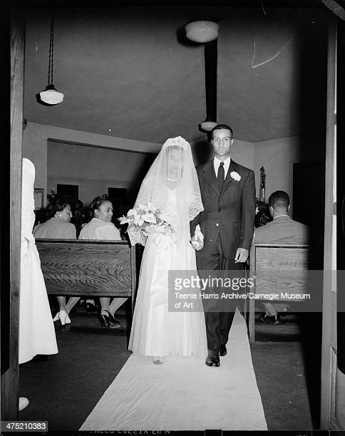 Bride Ruth McDonald Whaley and groom Walter James Whaley walking down aisle in St Matthews AME Zion Church Sewickley Sewickley Pennsylvania 1946