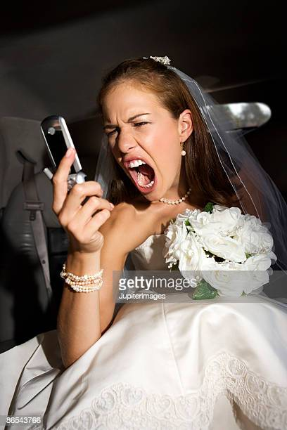 Bride screaming at cell phone
