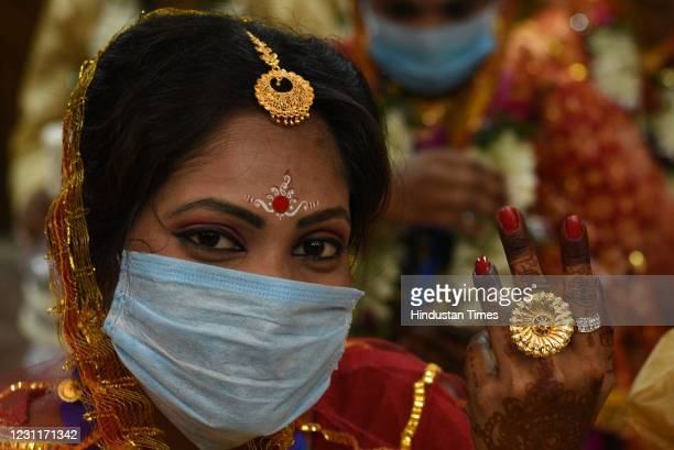 Bride seen during a mass marriage ceremony organised by NGO Aloy Phera, on February 14, 2021 in Kolkata, India. 70 people got married during the...