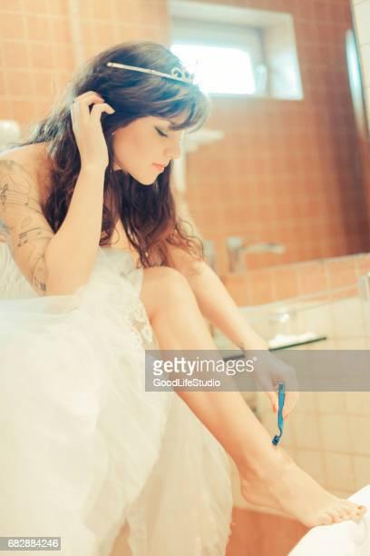 Bride shaving her legs