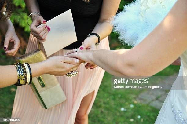 Bride showing her new ring to friends and family
