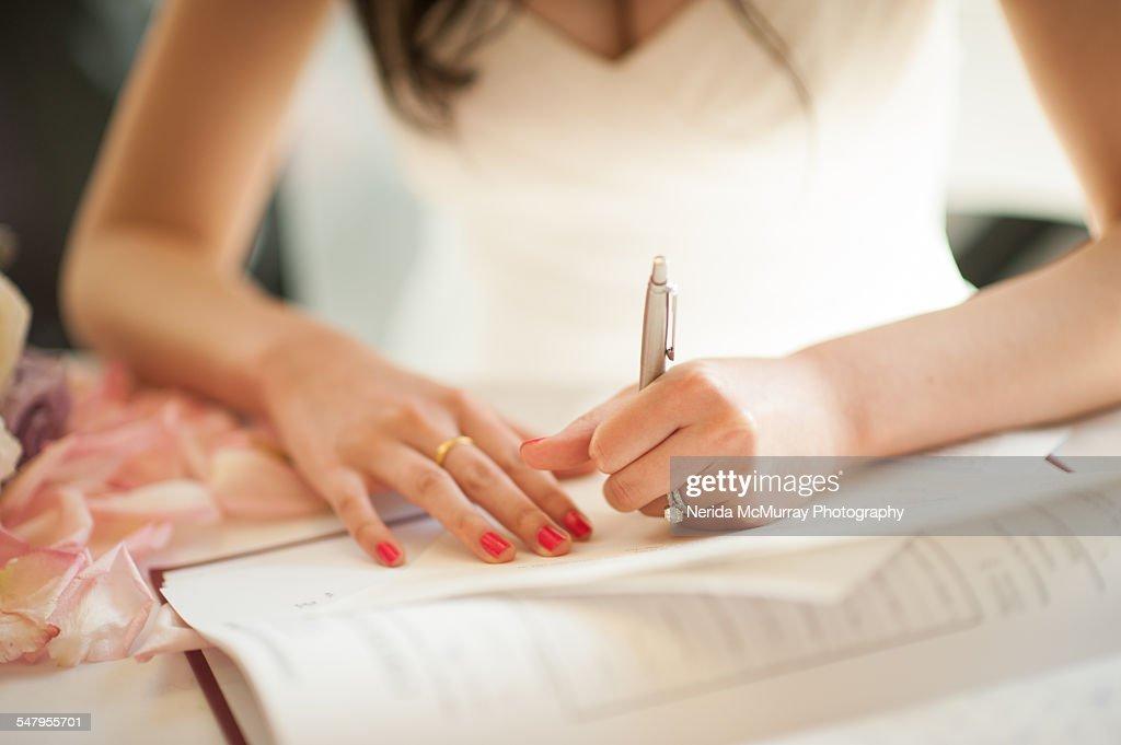 Bride Signing Wedding Register Stock Photo
