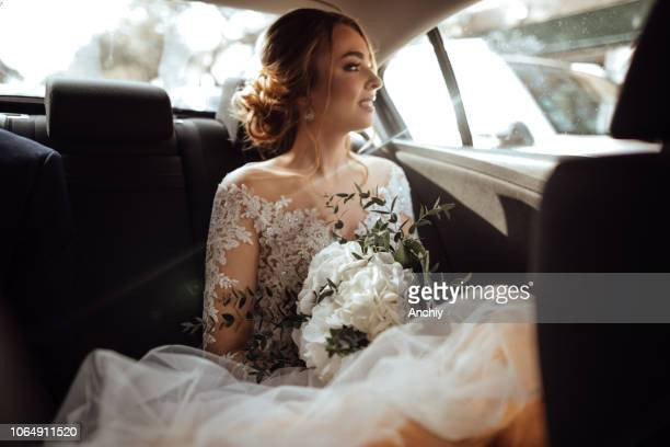 Bride sitting in the backseat