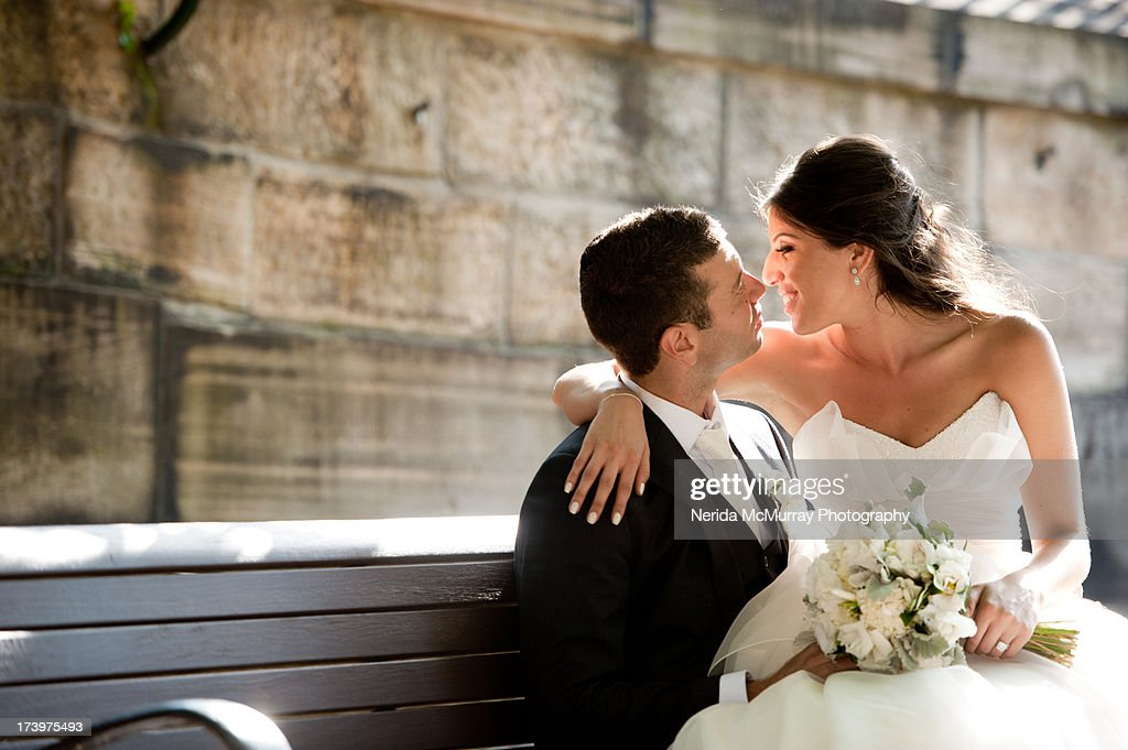 Bride sitting on groom's lap : Stock Photo