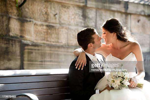 bride sitting on groom's lap - hochzeit fotos stock-fotos und bilder