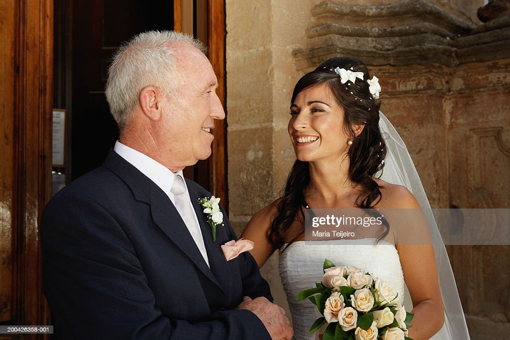 Bride smiling at father : Stock Photo