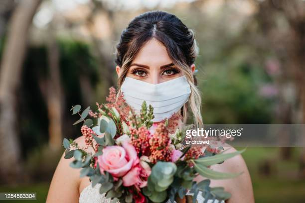 bride smiling behind the mask - bride stock pictures, royalty-free photos & images