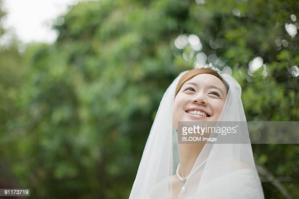 Bride smiling, looking upward