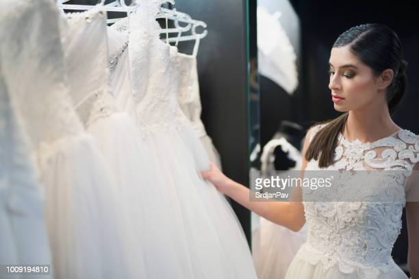 bride thinking about that dress.. - wedding dress stock pictures, royalty-free photos & images
