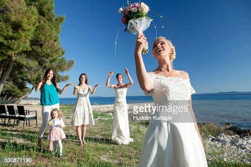Bride Throwing Bridal Bouquet Croatia Europe Stock Photo