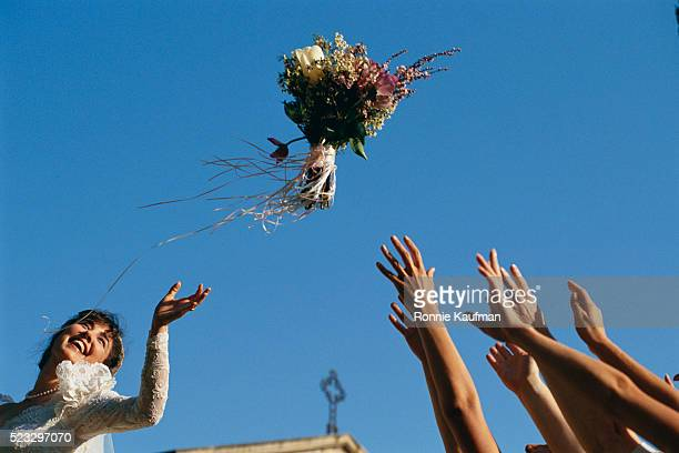 bride throwing bouquet - ceremony stock pictures, royalty-free photos & images