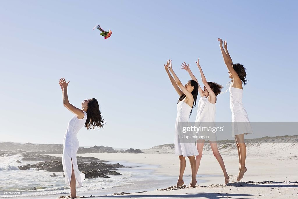 Bride throwing bouquet : Stock Photo