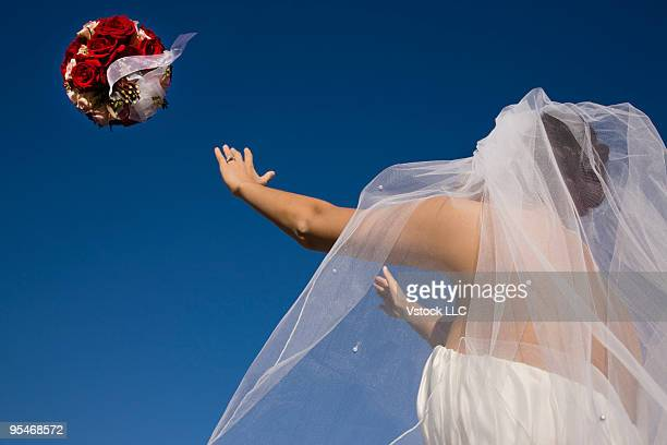 Bride throwing flowers