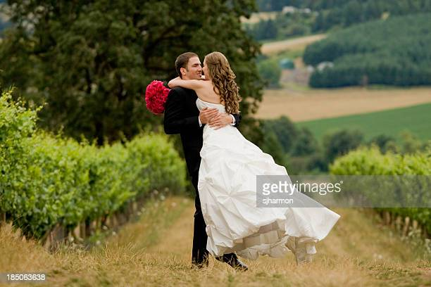 Bride throws herself to the Groom Embracing Her