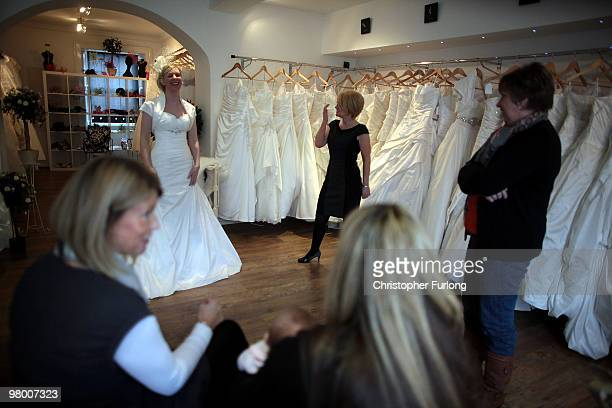 Bride to be Vicki Blaney tries on a wedding dress for size at I Do Bridal Designs in Cockermouth High Street on March 24, 2010 in Cockermouth,...