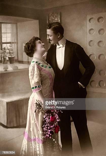 bride touching groom's face - 1900~1909年 ストックフォトと画像