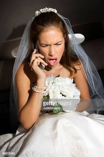 Bride using and screaming at cell phone