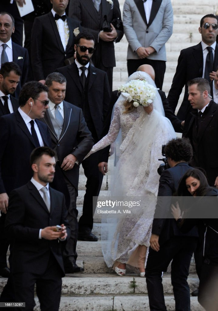 Bride Valeria Marini (C) and her husband Giovanni Cottone (2nd L) leave the church after their wedding at Ara Coeli on May 5, 2013 in Rome, Italy.