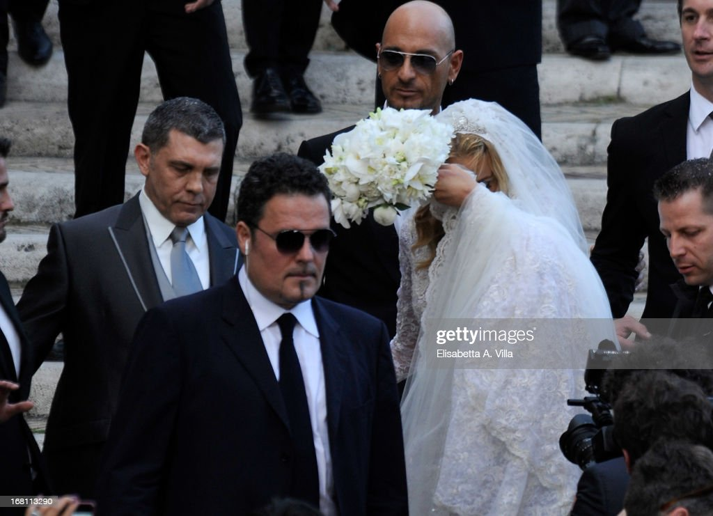 Bride Valeria Marini (R) and her husband Giovanni Cottone (L) leave the church after their wedding at Ara Coeli on May 5, 2013 in Rome, Italy.