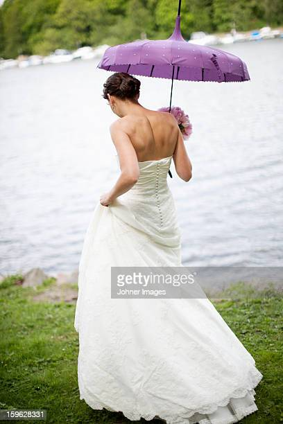 Bride walking on lakeside