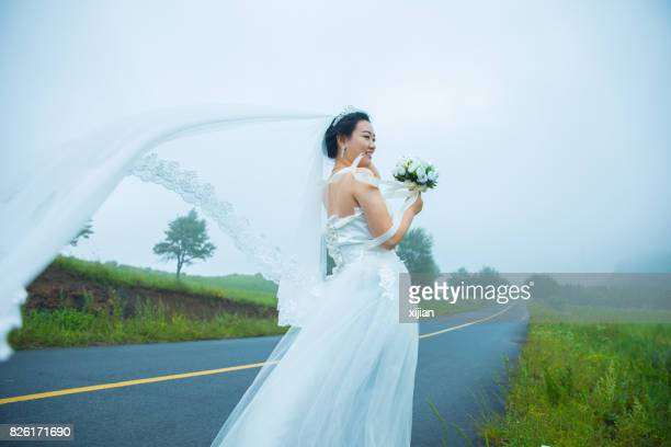 Bride walking on the road