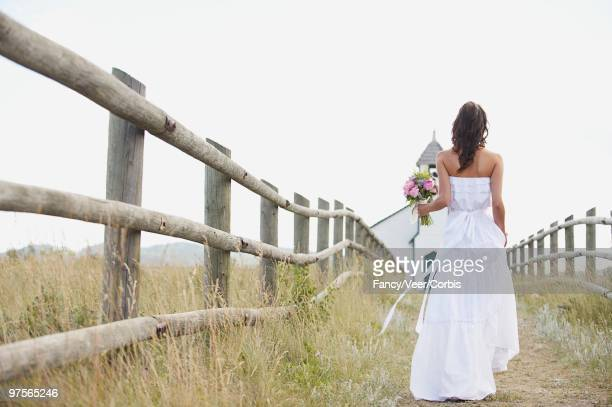 bride walking towards church - ponytail stock pictures, royalty-free photos & images