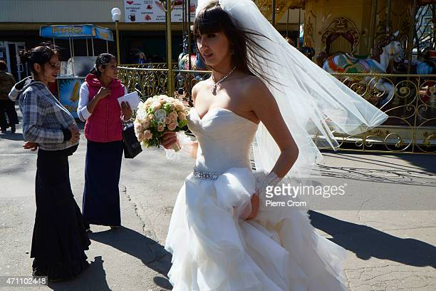 A bride walks allong two gypsies that was begging for money on April 25 2015 in Odessa Ukraine Fortytwo proRussian activists died when the building...