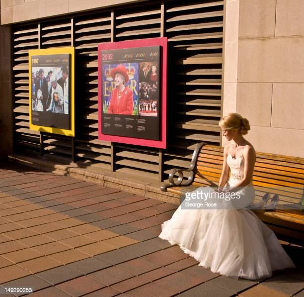 A bride wearing a white gown waits to have her picture taken outside the Fairmont Chateau Laurier Hotel on June 30 2012 in Ottawa Canada Ottawa the...