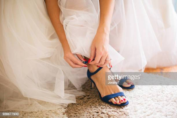 Bride wearing her blue high heels