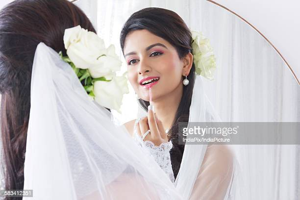 Bride wearing make up