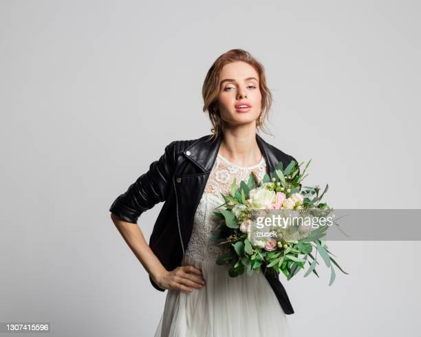 bride wearing weeding dress and leather jacket - embellished jacket stock pictures, royalty-free photos & images