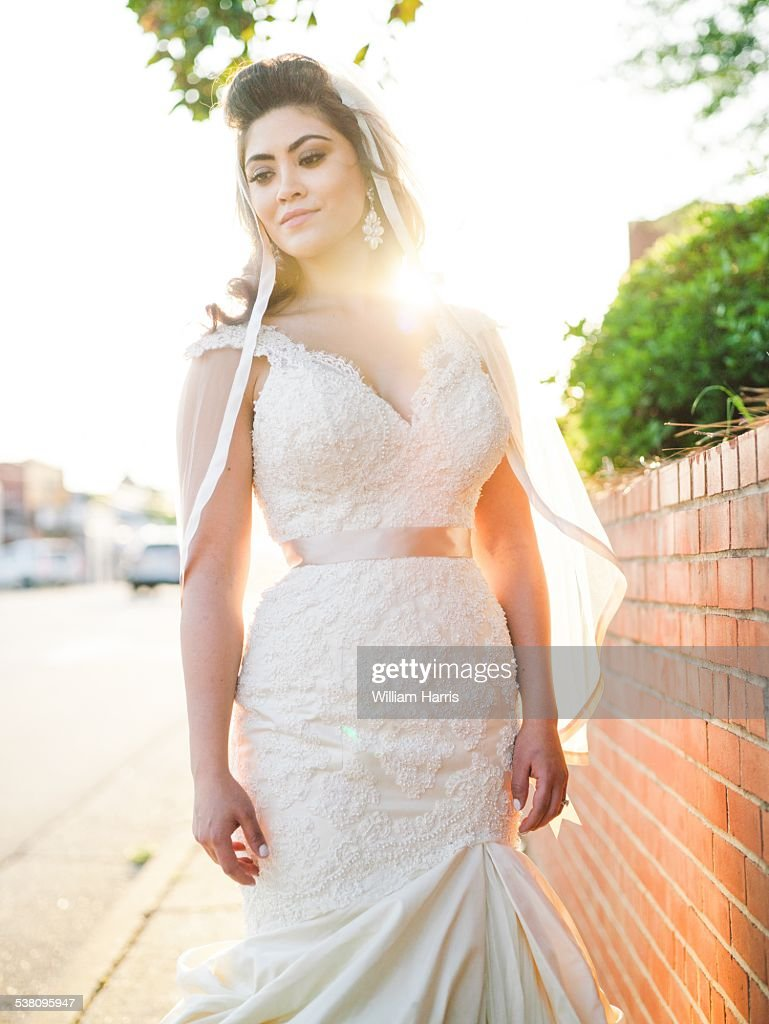 Bride wearing white wedding dress posing outside stock photo getty bride wearing white wedding dress posing outside stock photo junglespirit Image collections