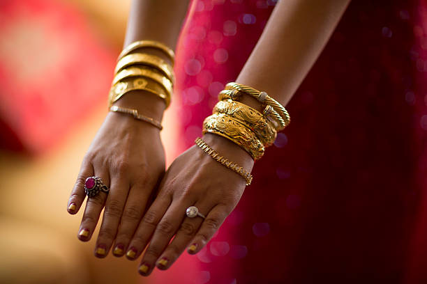 A Bride Wears Gold Bangles During The Tea Ceremony Of Her Wedding In Hong Kong