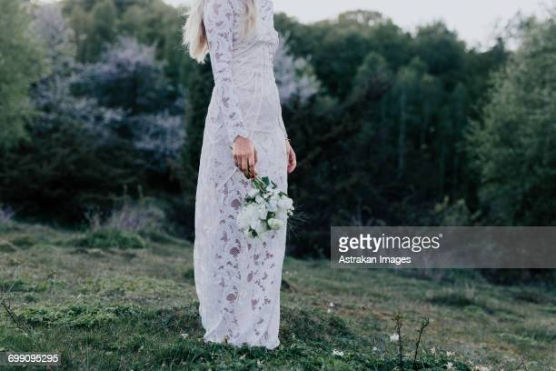 bride with bouquet - lace dress stock pictures, royalty-free photos & images