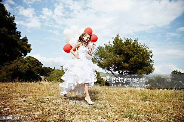 Bride With Bunch of Balloons On Meadow, Croatia Europe