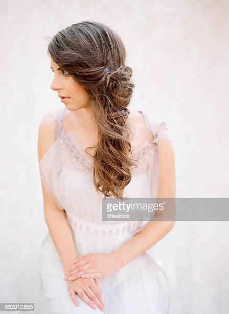 Bride with curled hair in wedding dress