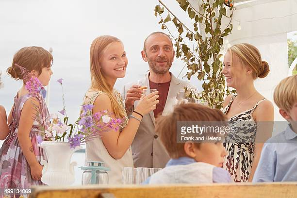 Bride with family and friends at wedding reception