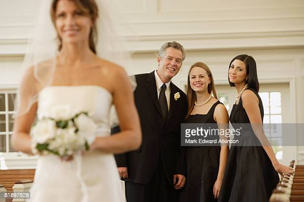 Bride with family in background