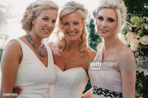 bride with her bridesmaids - white dress stock pictures, royalty-free photos & images