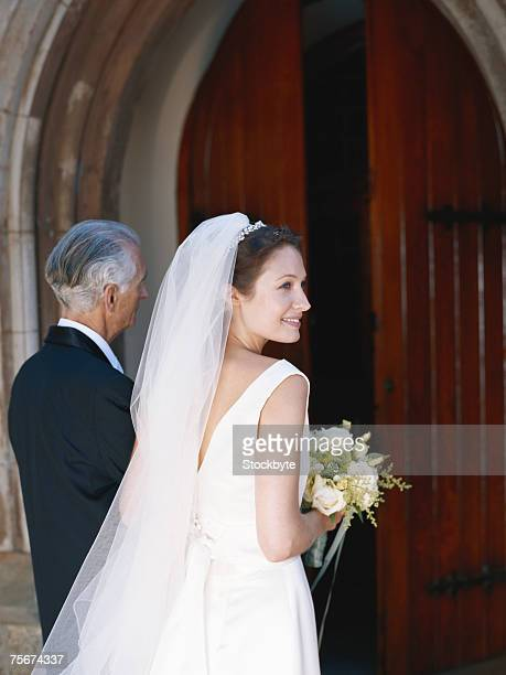 Bride with her father entering church
